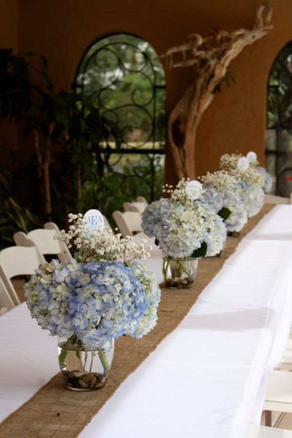 Blue hydrangeas with white buttons instead of baby's breath