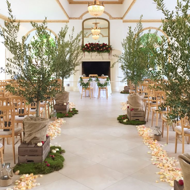 Stunning Autumn wedding aisle-The Vine Room, Northbrook Park.  Floral design created by Eden Blooms Florist.  Olive trees, rustic crates, pumpkins, moss, apples and fresh petals.