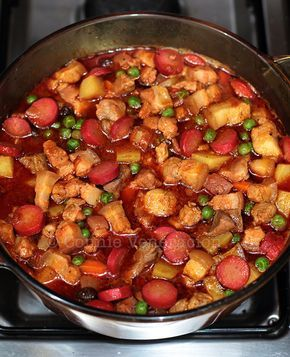 Filipino pork menudo is a tomato-based stew with pork belly, pork liver, potatoes, carrots and raisins. This is a slow cooker recipe for modern cooks.