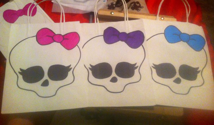 Monster High Party favor bags- White gift bags from The Dollar Tree and traced the Monster High Skull with permanent markers