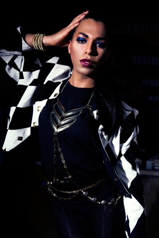Munroe Bergdorf wearing 1980's harlequin leather jacket with 1930 lace maxi skirt