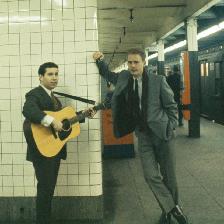 """Simon and Garfunkel, 5th Avenue and 53rd Street subway, 1964. Photo by Henry Parker (cover shoot for """"Wednesday Morning, 3am"""")."""