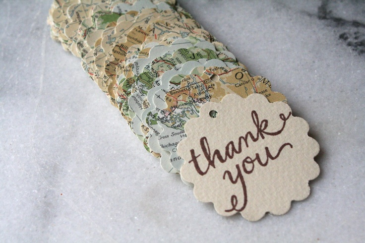 Map favor tags, 50, with hand-stamped thank you message, vintage atlas design, perfect for travel theme party or destination wedding. $25.00, via Etsy.