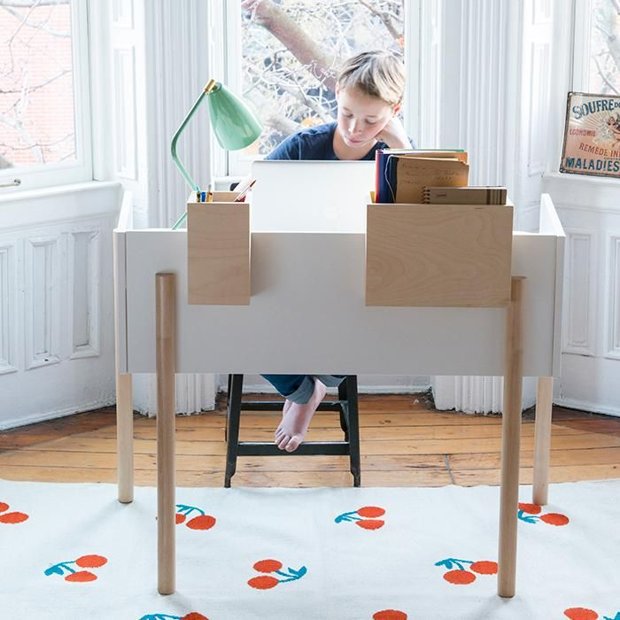 The Brooklyn desk provides an urban take on work space. With its adjustable height and moveable storage boxes, it can be endlessly used and adapted by every member of the family. Slim, rounded legs and removable storage boxes create a simple, chic design. The desk height is adjustable for growing children, up to adult height.