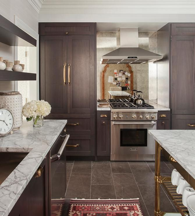 beautiful kitchen features dark brown stained cabinets adorned with
