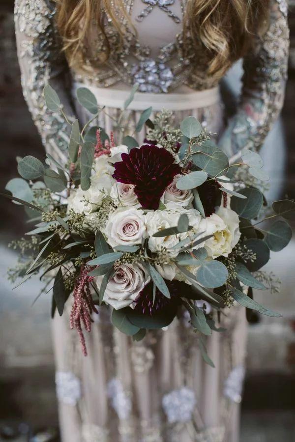 Glamorous wedding bouquet with burgundy dahlias, white roses and silver dollar eucalyptus