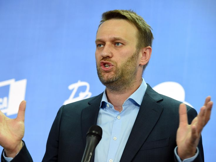 Russian opposition leader Alexei Navalny barred from standing against Vladimir Putin in election