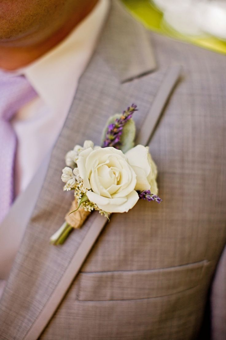 Groom: For the groom I would like it to be two white roses like this and a little lavender behind it (can be the same flower as the groomsmen but different purple color).