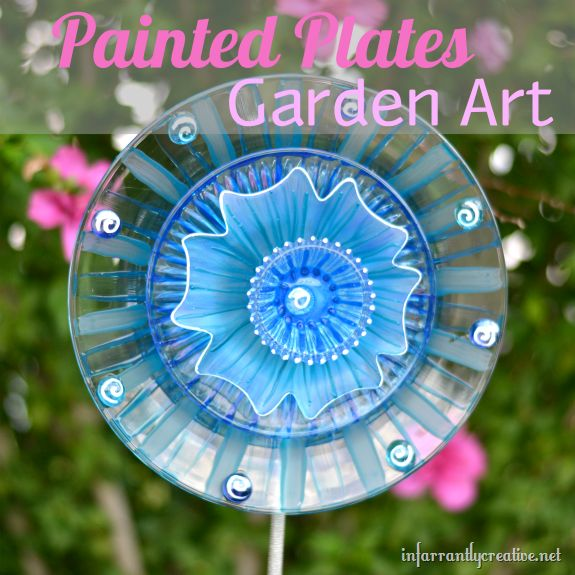 DIY::Glass plates from Dollar Tree turned into a bright 3-D flower that catches the sun in your garden!