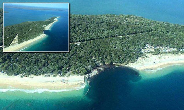 Giant SINKHOLE the size of a football field opened up at a QLD beach #DailyMail