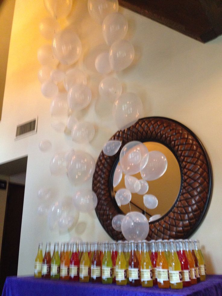 Balloons above a fizzy lifting drink display... love it!