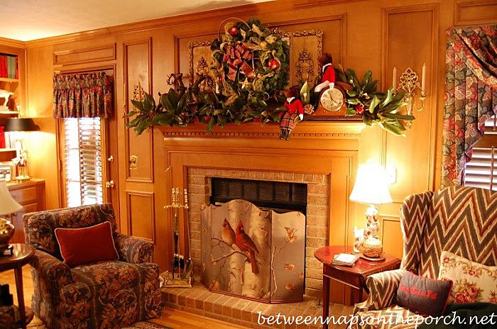 The warm colors or so inviting! I could probably make that fireplace guard too! 10 Ways to Decorate a Mantel for Christmas