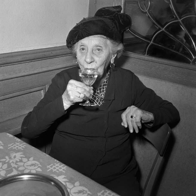 Anon:   Elderly lady in a restaurant, Lausanne  1959