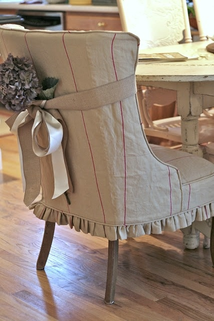 Love the slipcover and the embellishment.  It would be easy to change seasonally.: