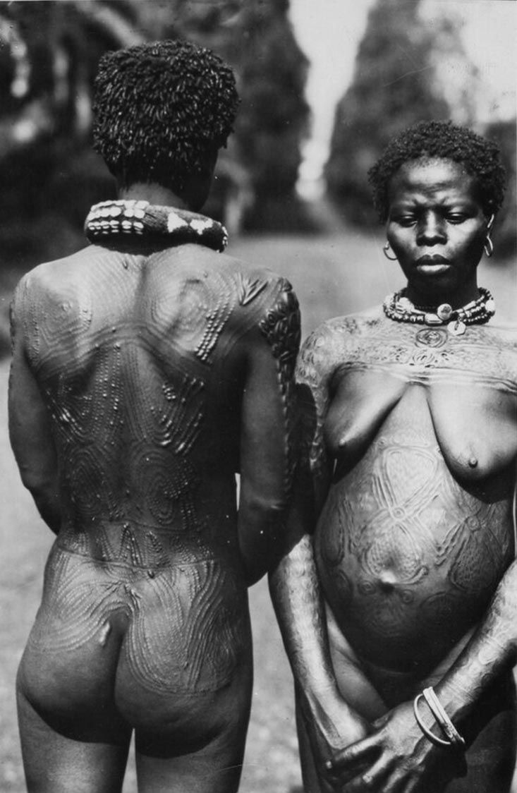 Africa | Scarification among the Bamileke people; man from the back and a woman from the front. Cameroon. ca. 1945 - 1979 | ©Bohumil Holas // PP0176562