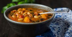 Based on the Chilean Porotos Granados, this vegan white bean stew includes butternut squash, kale, and fresh basil for a hearty and flavorful one-pot meal.