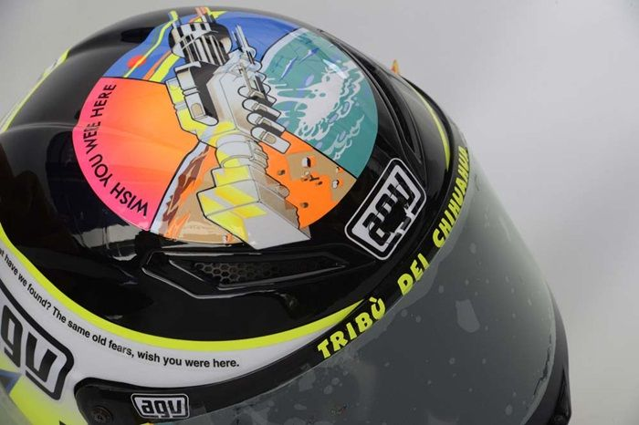 """Valentino Rossi 'Wish You Were Here' Helmet (Misano 2013): For the 2013 Italian MotoGP at Misano, Valentino came out with a beautiful tribute to the late Marco Simoncelli with a helmet design based on the song """"Wish You Were Here"""" by Pink Floyd.  This is one of Valentino's most personal and subdued helmet designs that he has ever produced, and it became an instant fan favorite."""