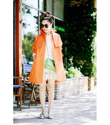 Karen Walker Super Duper Strength Sunglasses ($280); J.Crew Cotton Twill Swing Trench ($248) in Sunbaked Orange; vintage dress; Mulberry bag; Miu Miu loafers.