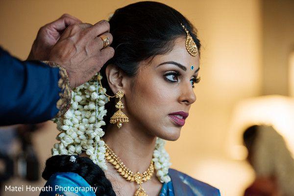 South Indian bride. Temple jewelry. Jhumkis.Blue silk kanchipuram sari.Braid with fresh jasmine flowers. Tamil bride. Telugu bride. Kannada bride. Hindu bride. Malayalee bride.Kerala bride.South Indian wedding.