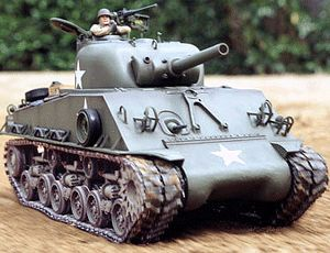 The Tamiya R/C Sherman DMD in 1/16 is a radio control model tank kit. Tamiya's all new M4 Sherman 105mm Howitzer tank has been designed for maximum ease-of-use and for control by either a 2-channel or 4-channel R/C system. Since Tamiya is behind this R/C M4 Sherman, authenticity in scale, body detailing, and working suspension goes without saying.