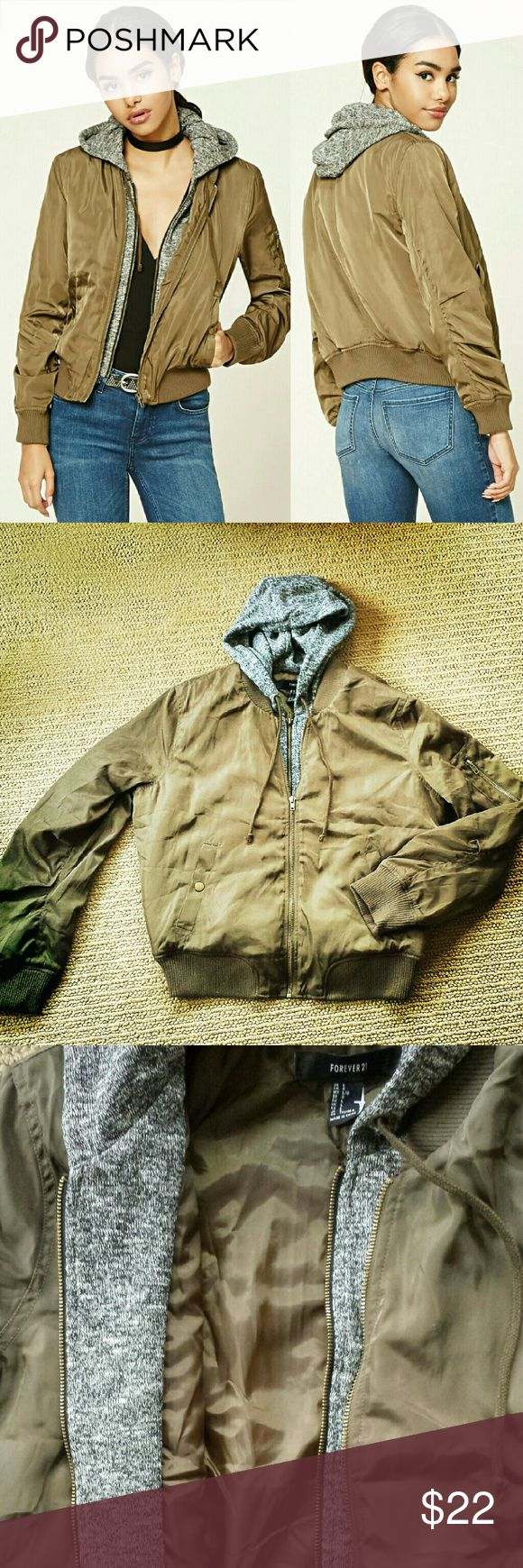 f21 Hooded Bomber Jacket Olive green padded bomber jacket with faux-layered marled knit hoodie buttoned front pockets, one on-sleeve zip pocket, and interior and exterior zipper layers  length: 23in chest: 42in waist: 38in sleeve length: 23.5in Forever 21 Jackets & Coats