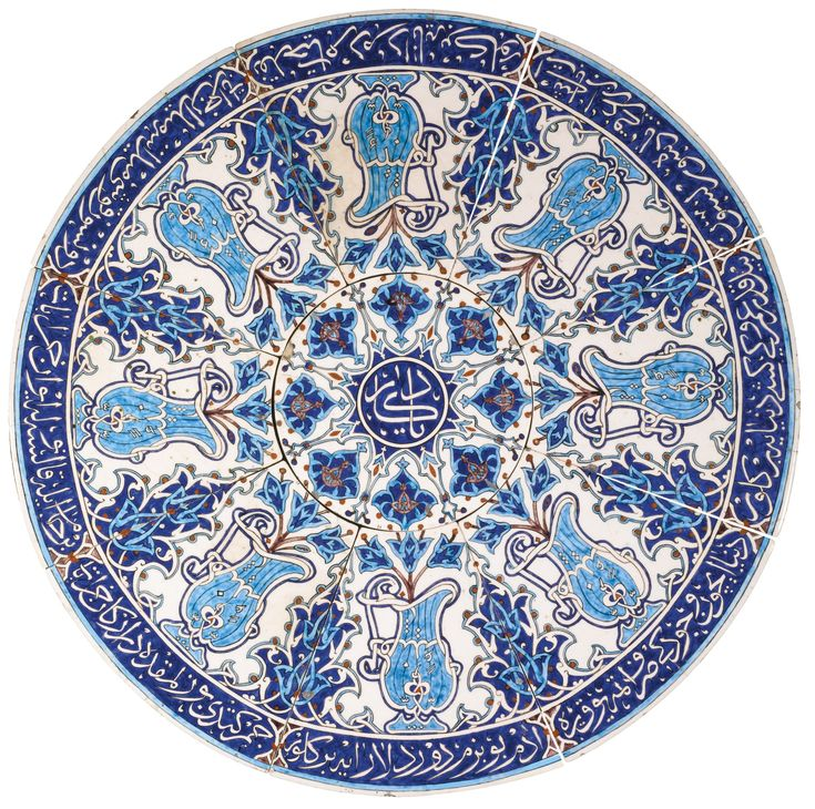A Kutahya pottery coffee table top, Turkey, 19th century, comprising a central circular tile with eight fitted tiles surrounding it