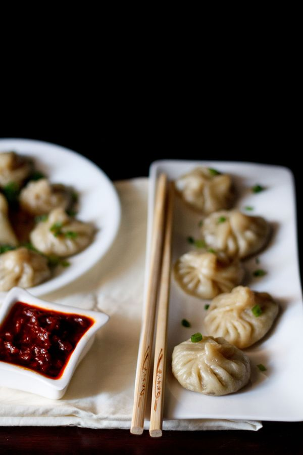 vegetable momos recipe made from scratch - steamed dumplings stuffed with a lightly spiced vegetable filling. a popular tibetan recipe. step by step pictorial recipe with a helping video to show shaping of momos.