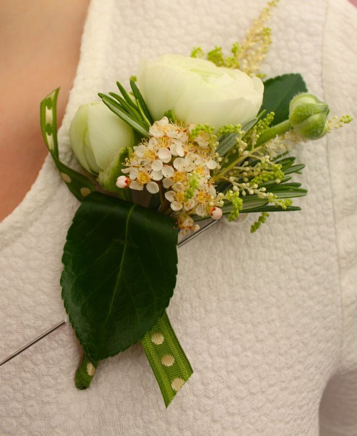 White Ranuncula buttonhole.