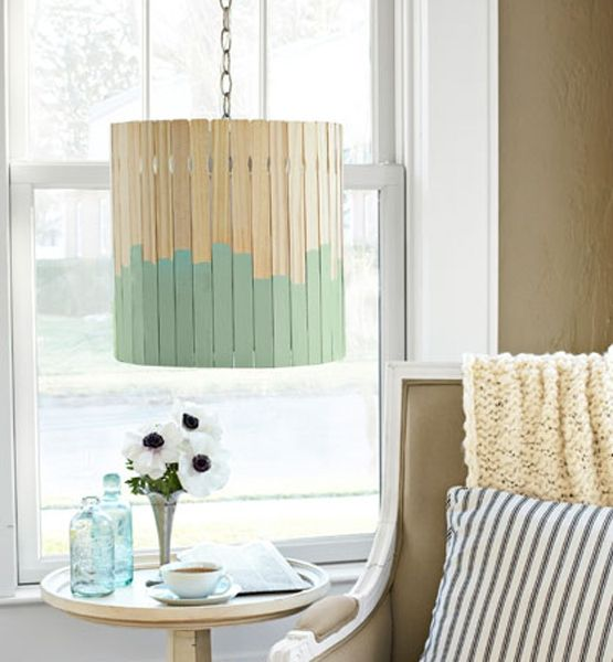 Transform a basic shade with paint sticks. Those hardware-store stirrers can do more than just blend semigloss. Instead, use them to ring any cylindrical shade that's up to 14 inches tall.