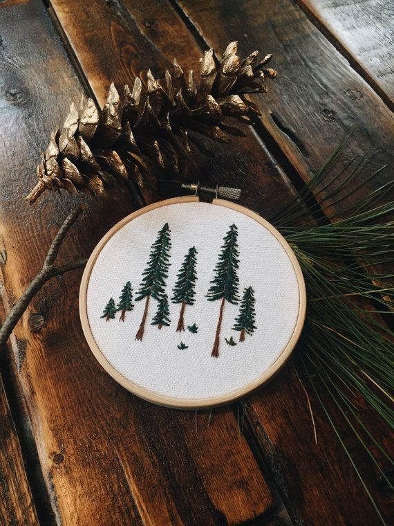 Pine Tree Embroidery Hoop This is a 4 wooden hoop with a hand embroidered pine tree design. This piece is set in a wooden embroidery hoop frame and can easily be hung up or set out on display. Great to give as a housewarming gift or Christmas present. Note: Each item is hand-stiched
