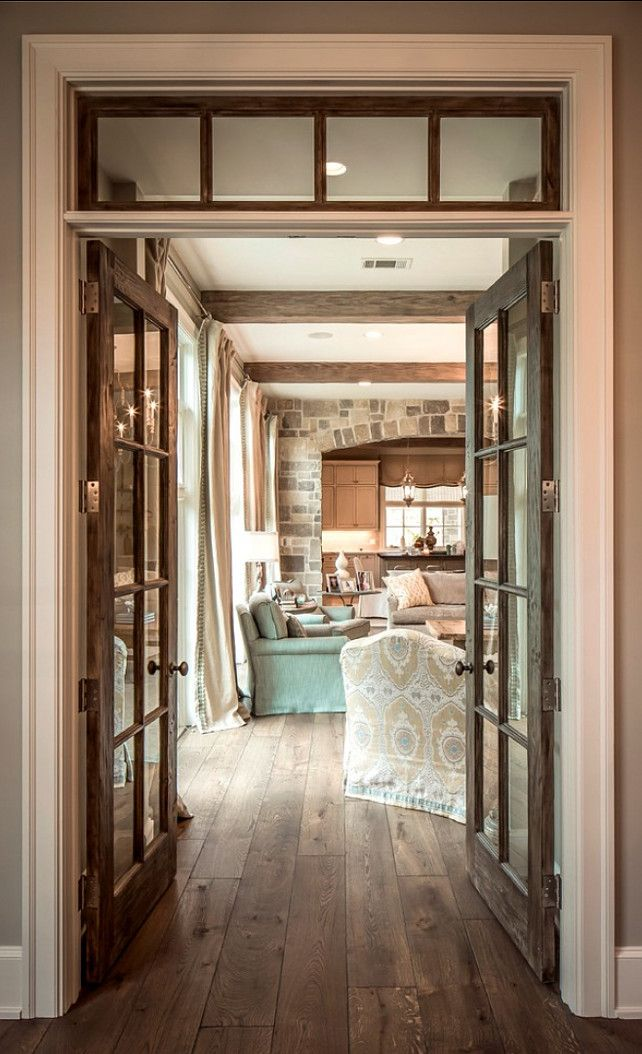 Rustic French Interior With French Doors, Transom And Gorgeous Hardwood  Floors. Love The Arched Stone Wall Between The Living Space And The Kitchen.