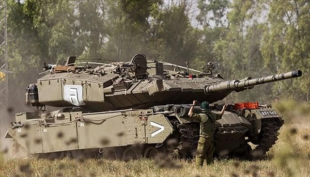 Pictures released on Internet during the Israeli military operation Protective Edge has showed a new version of the Magach main battle tank fitted with an anti-tank guided missile launchers Spike. The Magach 5 tank is based on the old American-made M48A5 main battle tank.