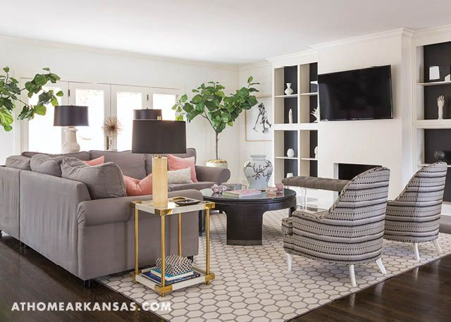 The Main Family Hang Out Space, The Living Room, Is Anchored By A Sectional  Sofa And Patterned Rug. A Pair Of Fiddle Leaf Fig Trees Adds A Natural, ...