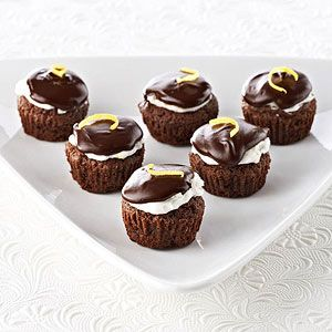 Preheat oven to 350 degrees F. Line fourteen 1-1/4-inch muffin cups with paper bake cups; set aside. In a medium saucepan, heat and stir the 1/2 cup Ghirardelli® 60% Cacao Bittersweet Chocolate Baking Chips and the 1/4 cup butter over very low heat until melted and smooth. Remove from heat. Stir in sugar. Add egg, beating with a wooden spoon until just combined. Stir in vanilla. In a small bowl, stir together flour, the 1/2 teaspoon lemon zest, and the baking powder. Add flour mixture to…