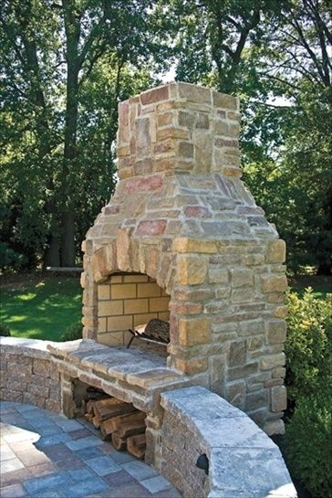 Outdoor fire place with wood storage underneath