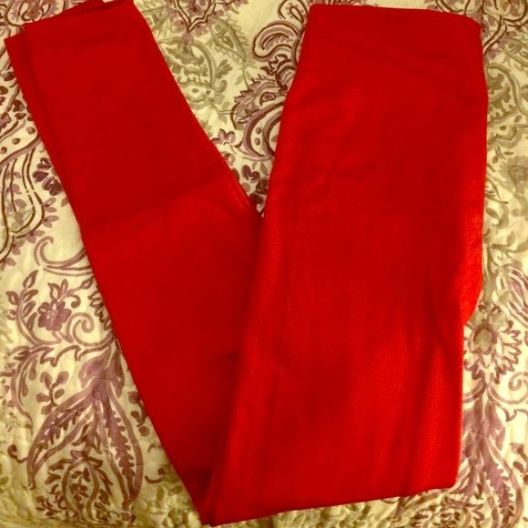 NWOT Red Leggings Red fleece lined leggings. Super comfy! Size is OSFM, but is most closely to a s/m. Pants Leggings