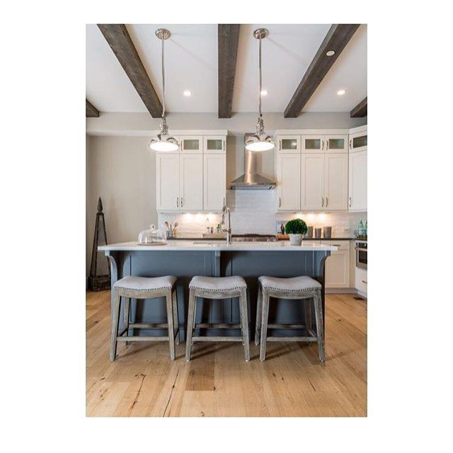 It's all the details that make this kitchen come together. White oak floors and reclaimed beams add warmth while polished nickel lighting and hardware add some shine. Counter stools by @gabbydecor make it cozy and inviting. By @restyledesign by @kathypedenphotography #oldtownfortcollins #fortcollinsinteriordesign #fortcollins #brownesonhowes #gabbydecor #woodbeams #hbg #whitekitchen #northerncolorado #fortcollinsrealestate