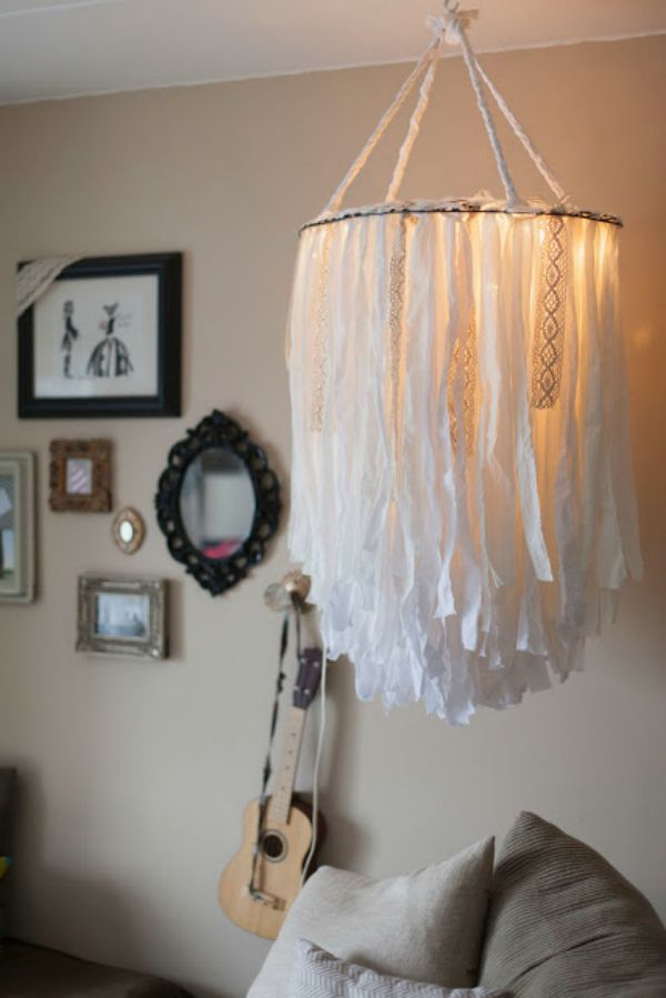 Enjoy a warm glow with this luxe light fitting made from fabric strips and lacy…