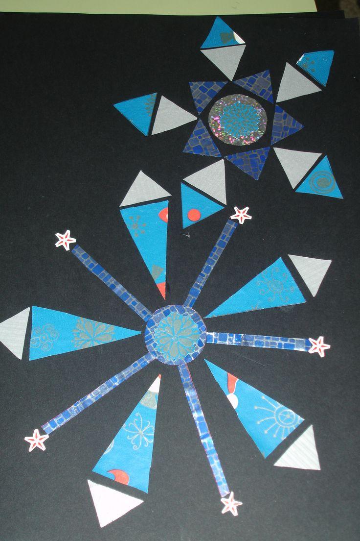 Tapa d'album feta amb formes geomètriques i paper de regal.