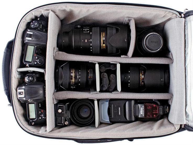 may I just say... this is my goal in life. that many cameras and lenses. OH yes