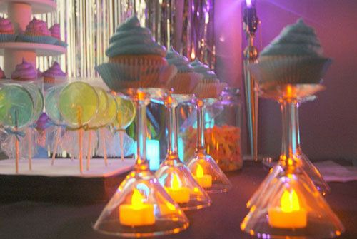 Individual Cupcake Stands: Tealights and martini glasses are all you need to present your cupcakes in a fabulously luminescent way.