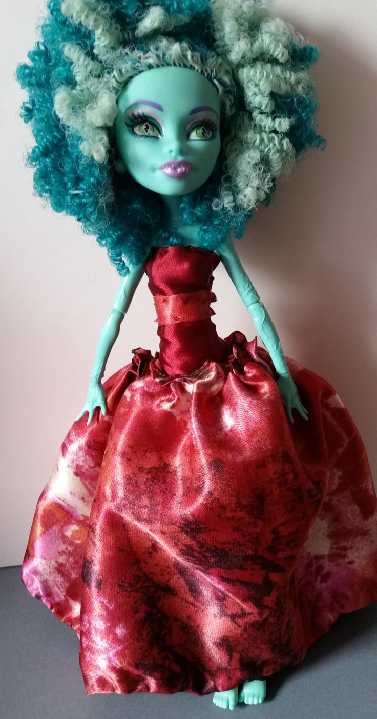 Silky handmade doll dress that fits Monster High dolls.  You can find my dress at etsy.com. My store name is bffknits.