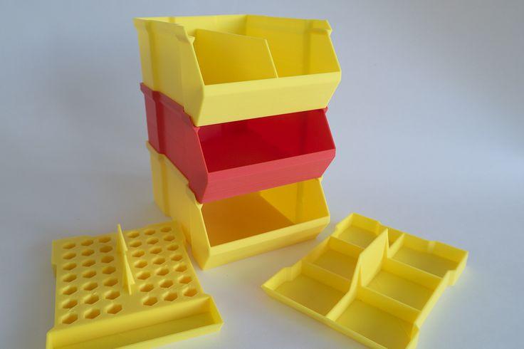 Krabičky, tiskárna Rebel 2Z, tryska 0,4 mm, výška vrstvy 0,3 mm, materiál červené a tmavě žluté PLA.