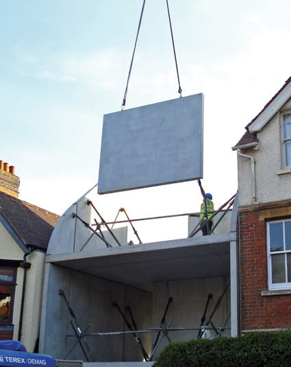 Hill Top House, lowering precast panels into place.