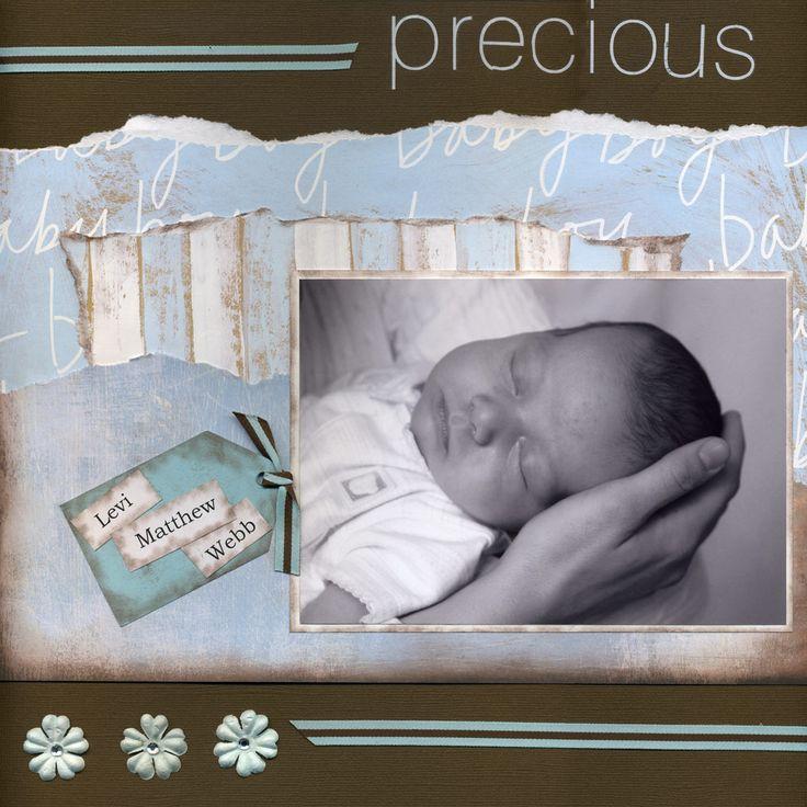 Baby Boy - Scrapbook.com Great shot of baby's head in an adult hand.