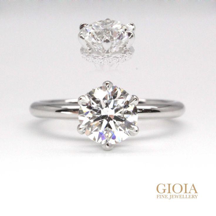 Unique Platinum Diamond Ring   Halo set your diamond ring in a unique way? Solitaire diamond engagement ring, with round brilliant diamonds set horizontally. Fine polishing without rhodium plating, a truly stunning white look.