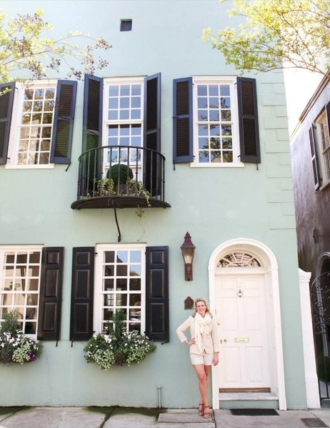 mint green house with white windows and black shutters