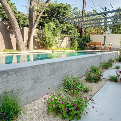 Raised pool design with concrete.