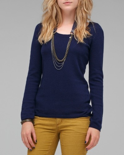 ink blue sweater with mustard skinny pants