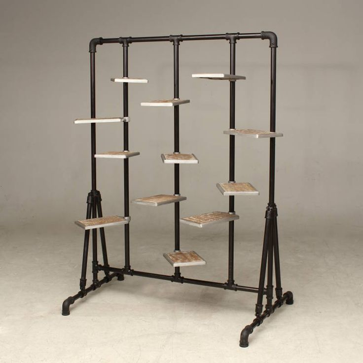 Adjustable shoe stand in steel pipe wood and cast iron for Retail furniture